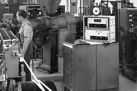 Woman working on a production machine